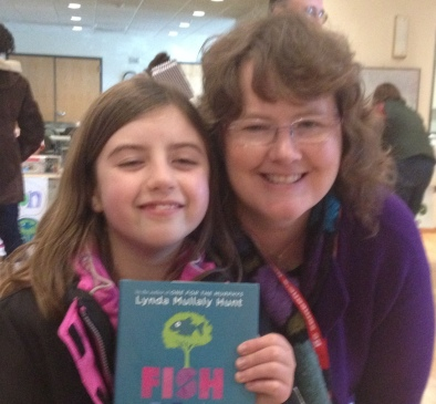 Lynda Mullaly Hunt signed my daughter's copy ofA FISH IN A TREE at her book launch.